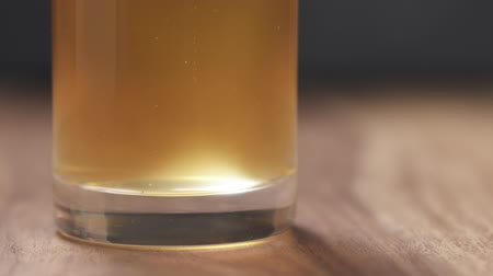 craft beer : Slow motion pan air bubbles in unfiltered wheat beer
