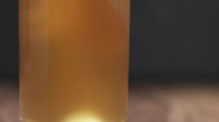 craft beer : Slow motion pour unfiltered wheat beer in glass on table Stock Footage