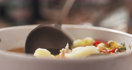 panelas : Slow motion closeup scooping cauliflower soup from bowl on wood table Stock Footage