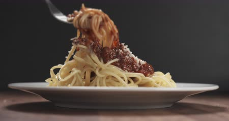 parmigiano : Slow motion eating spaghetti with bolognese sauce with fork Stock Footage