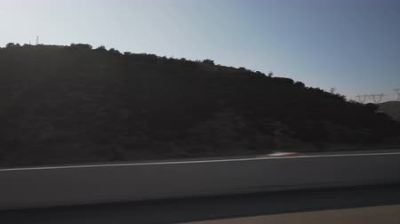 point of view pov : side view from moving car of mountains near Los Angeles