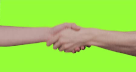 рукопожатие : adult male and teen female hands handshake over green screen