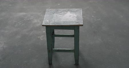 tabouret : Slow motion handheld shot of old stool in empty room during renovation Stock Footage