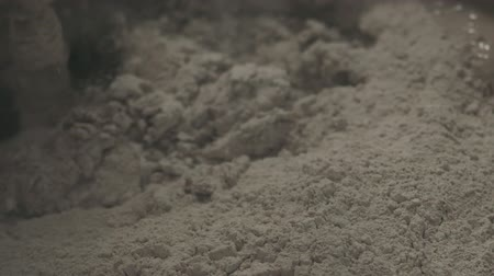 mikser : Slow motion pan shot of mixing concrete plaster with electric mixer Stok Video