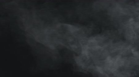 влажность : slow motion vapor steam from right side over black background