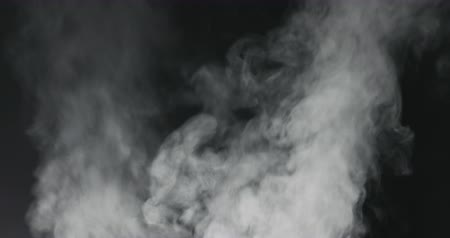 black and white : slow motion vapor steam rising over black background