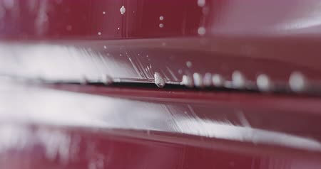 detailing : Closeup handheld red car wash shampoo soak