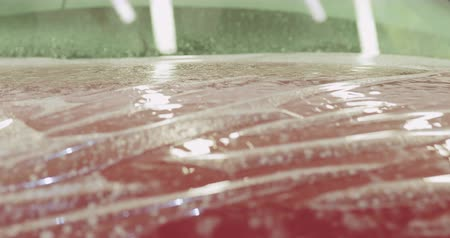 formado : Slow motion handheld applying protective film to the red car Vídeos
