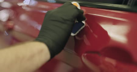 detailing : Slow motion closeup applying ceramic coating on the red car