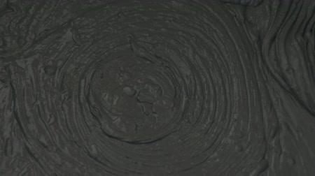 смесь : Slow motion closeup mixing dark gray micro concrete plaster