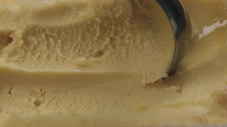 engorda : Slow motion closeup scooping orange sorbet