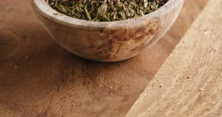 oregano : Closeup pan of dried provence herb mix in wood bowl for seasoning on table