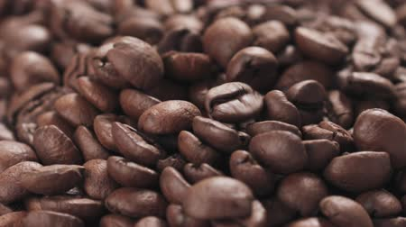 prim : Slow motion closeup coffee beans falling into bowl Stok Video