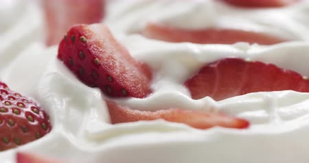 pivoting : fresh sliced straberries in cream rotating background loopable