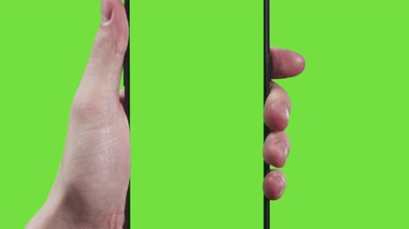 arrasto : 11 young man hand touch gestures with smartphone on green screen