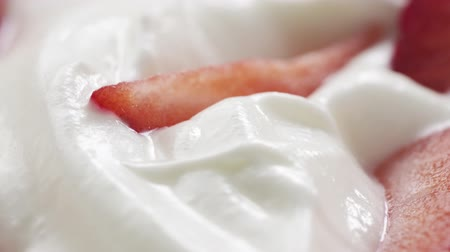 pivoting : fresh sliced straberries in cream rotating background