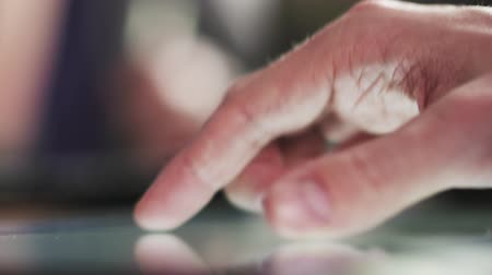 sörf : young man hands using tablet pc on table closeup