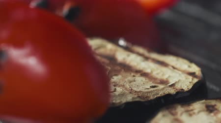 panelas : Slide slow motion shot of flipping eggplant and pepper on grill pan