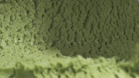 prim : Slow motion of pistachio ice cream being scooped close up