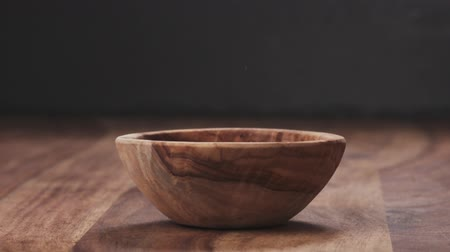 soyulmuş : Slow motion dried pecan nuts falling into wood bowl Stok Video