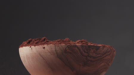 yermantarı : Slow motion truffle falling into cocoa powder in bowl Stok Video