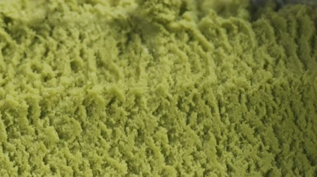 engorda : Slow motion closeup matcha ice cream scooping Stock Footage