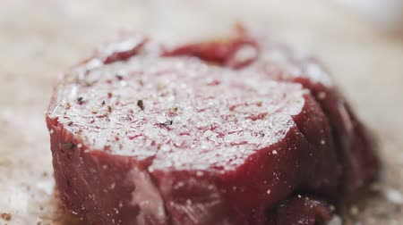 biber : seasoning raw beef fillet for steak on wooden board
