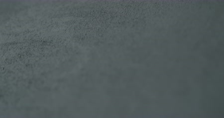 rachado : Slow motion shot of decorative dark concrete surface, shot handheld