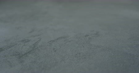 ラフ : Slow motion shot of decorative dark concrete surface, shot handheld