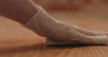 wood : Closeup man in gloves cleaning ash wood floor with wet cloth Stock Footage