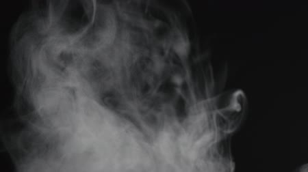 腫れぼったい : Slow motion of water vapor cloud comes from below over black background