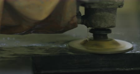 angle grinder : Slow motion handheld wet grinding concrete countertop