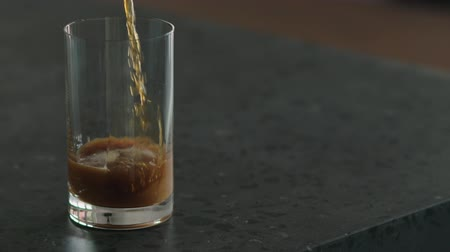 fotokopi makinesi : Slow motion pour nitro coffee into glass on terrazzo surface