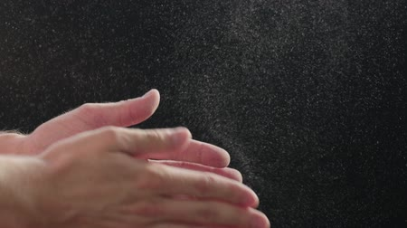 powerlifter : Slow motion closeup man clapping hands with fine powder