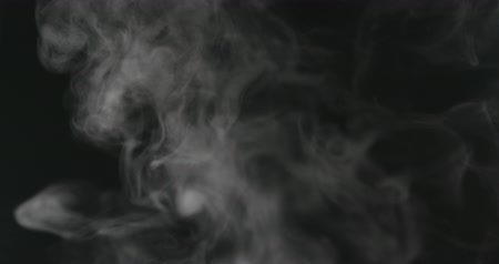 fuvalom : Slow motion water mist puff stream over black background