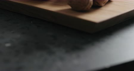 walnut shell : Slow motion pan of walnuts in olive bowl on terrazzo countertop Stock Footage