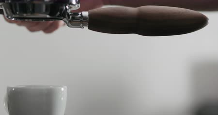 portafilter : Slow motion side view of espresso extraction with bottomless portafilter