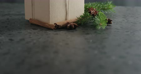 anason : Tilt shot of brown gift box with natural decorationson terrazzo countertop Stok Video