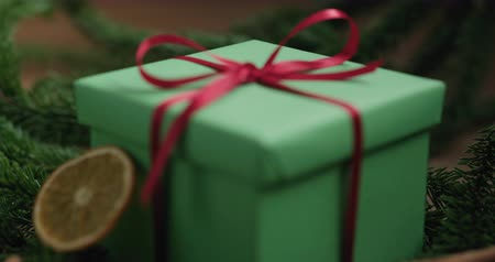 focus pull : Closeup focus pull reveal green gift box with christmas decorations