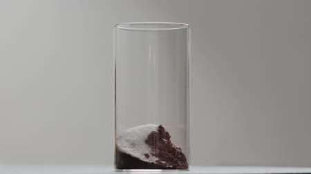 amargo : Slow motion making cocoa, add sugar into glass