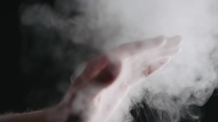 aesthetics : Slow motion man hand playing with water mist