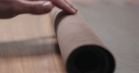 orzech : Slow motion man rolling brown leather piece and take it away closeup