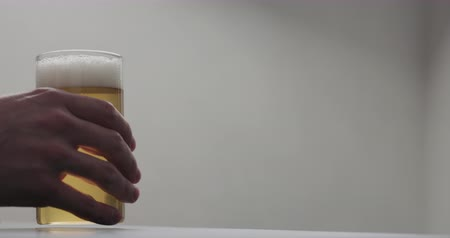 craft beer : Slow motion man hand take glass of cider with copy space Stock Footage