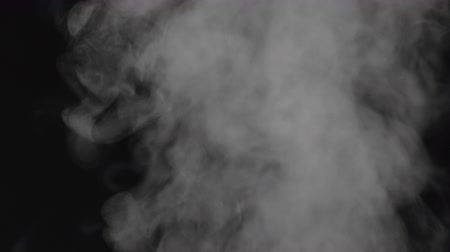 bafat : Slow motion water mist puff cloud over black background