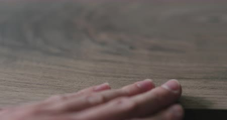 black walnut : Slow motion slide shot of man hand checking untrated black walnut solid board