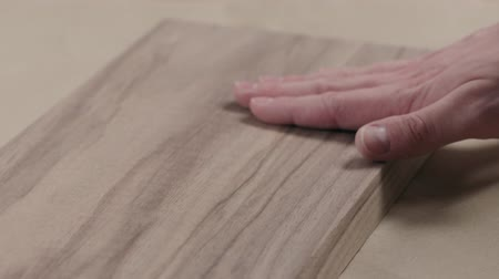 black walnut : Slow motion man hand touches black walnut board Stock Footage