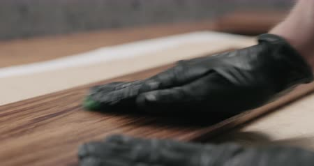 black walnut : Slow motion man sanding black walnut after oil application with abrasive pad Stock Footage