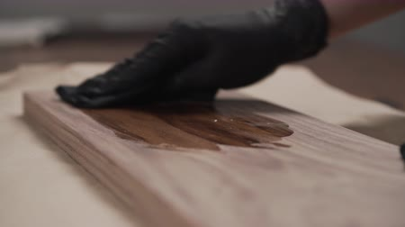 wood panel : woodworker applying oil finish to black walnut board