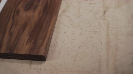 wood panel : man sanding black walnut after oil application with abrasive pad