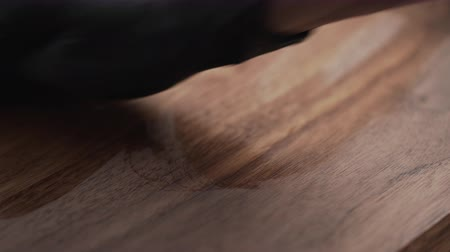 wood panel : woodworker applying oil finish to black walnut storage box Stock Footage